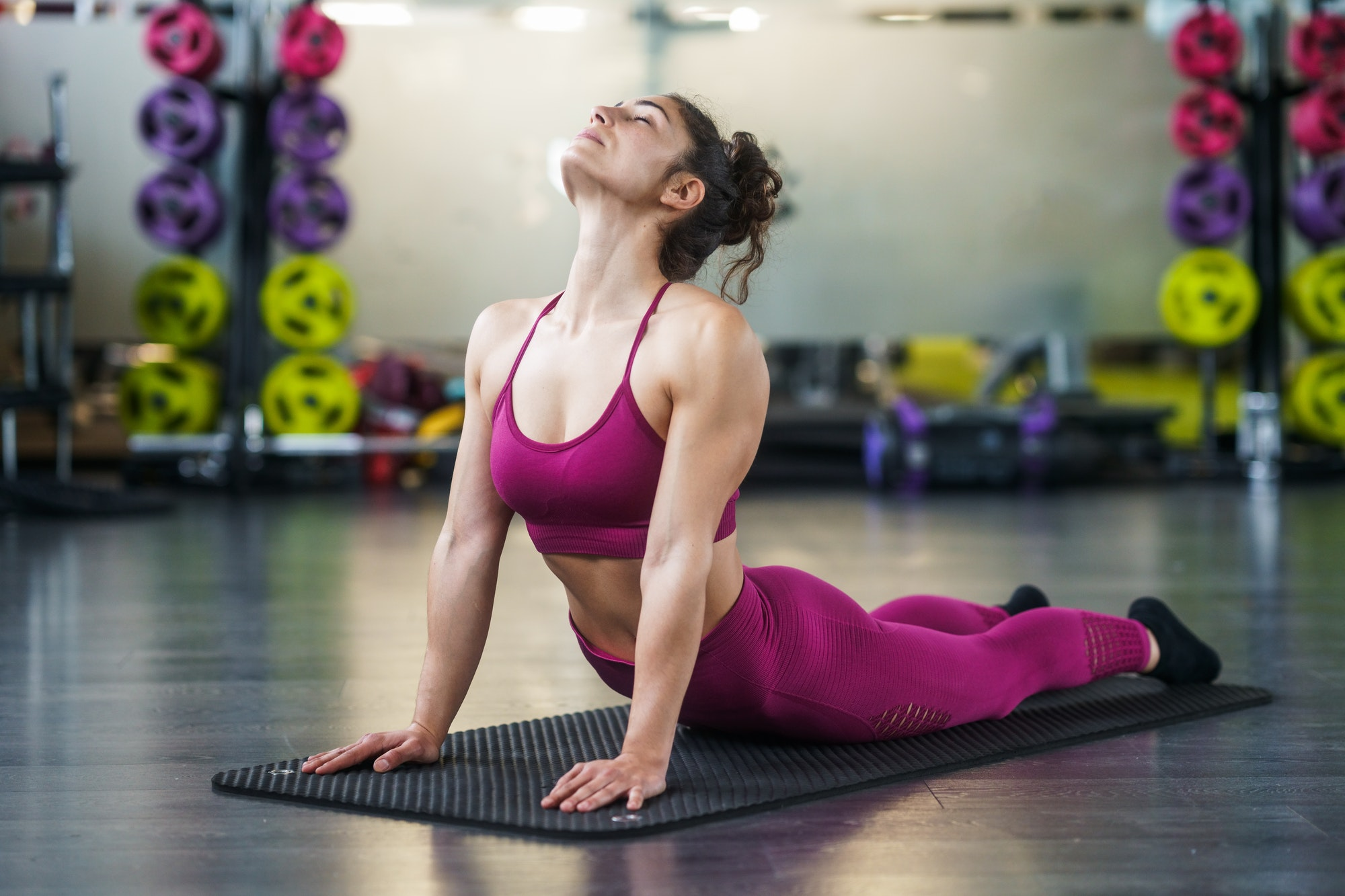 Young woman Doing Stretching Exercises on a yoga mat